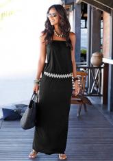Zwarte bandeaujurk met zigzag-ceintuur